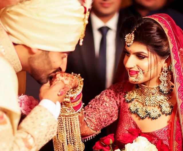 A Beautiful Bridal Lehenga and the Heavy Bridal Jewellery seems too tempting to not look at!-A Royal Wedding Tale